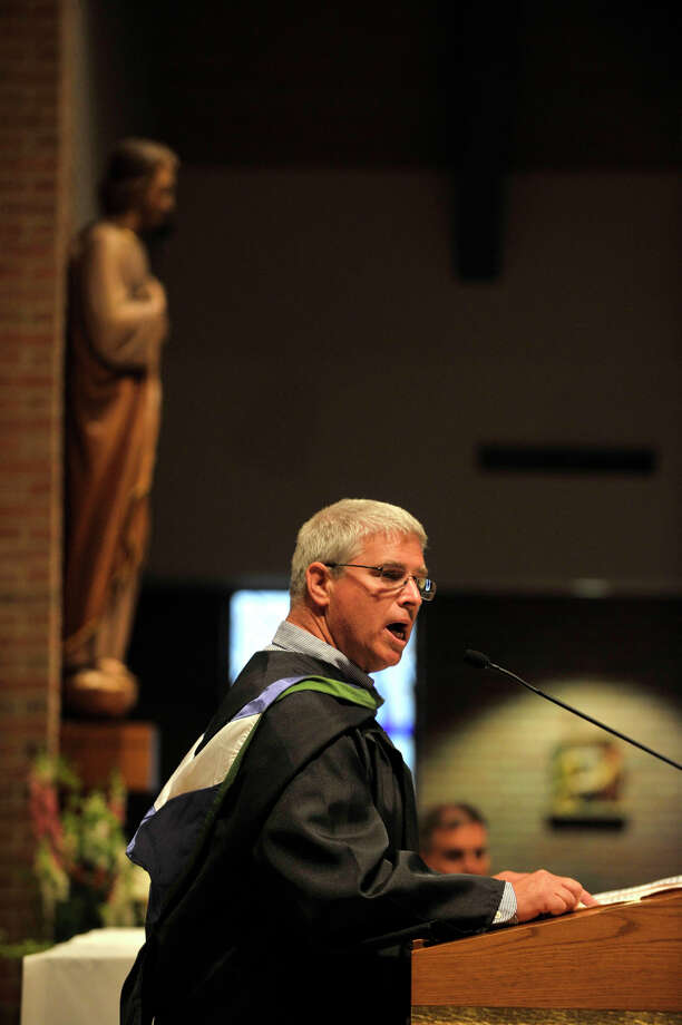 Physical education teacher Robert Plulmb speaks during the Immaculate High School graduation at Church of St. Mary in Bethel, Conn., on Wednesday, June 6, 2012. Photo: Jason Rearick / The News-Times