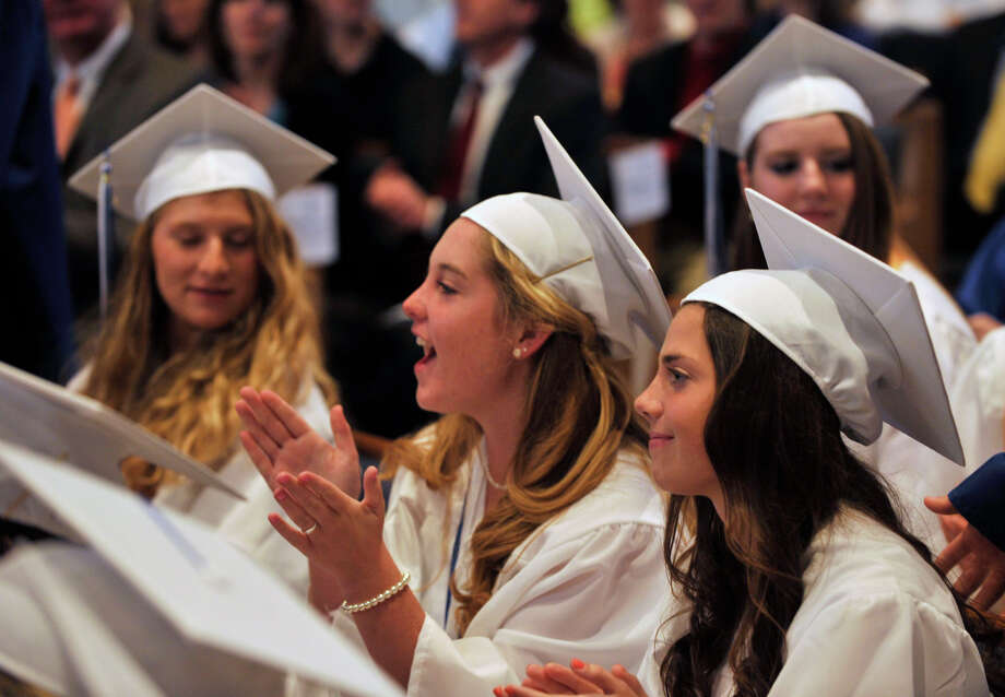 Kate Stevens, center, claps during the Immaculate High School graduation at Church of St. Mary in Bethel, Conn., on Wednesday, June 6, 2012. Photo: Jason Rearick / The News-Times