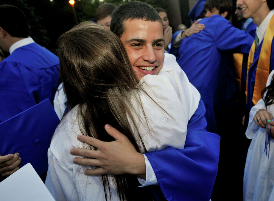 David Lasco, of New Fairfield, hugs Sarah Angermann, of Brookfield, after the Immaculate High School graduation at Church of St. Mary in Bethel, Conn., on Wednesday, June 6, 2012. Photo: Jason Rearick / The News-Times