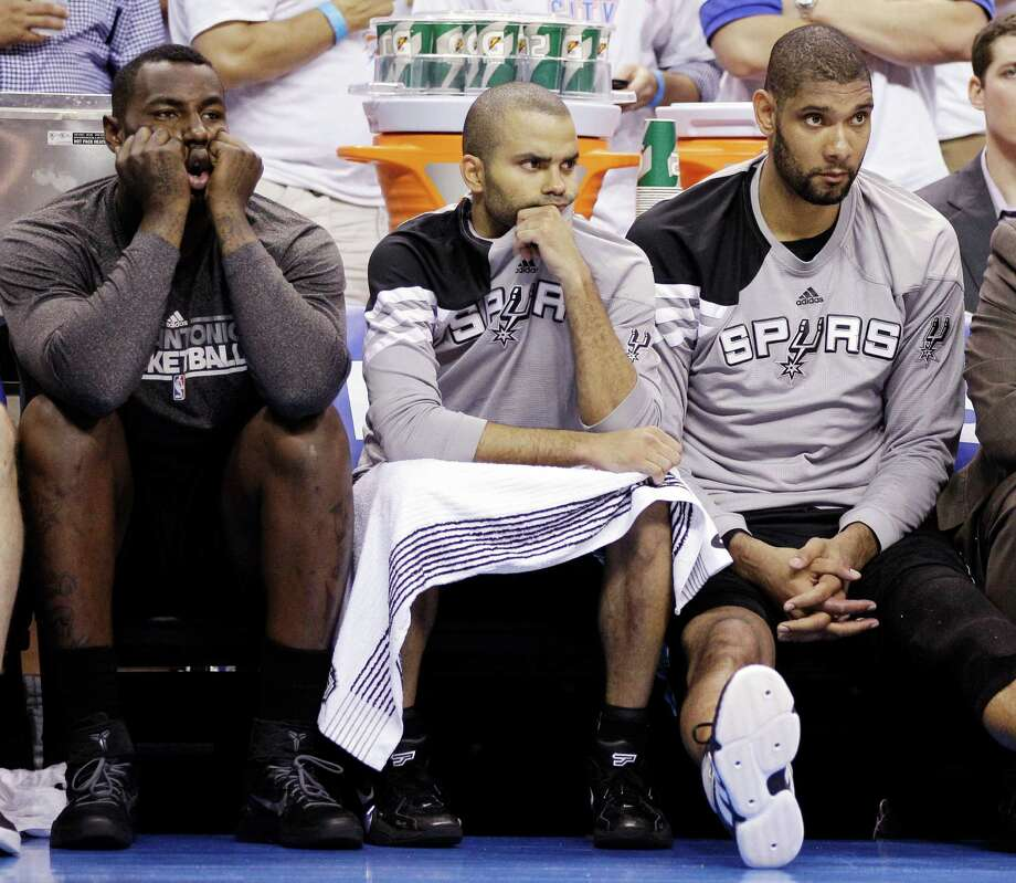 From left, San Antonio Spurs forward DeJuan Blair, point guard Tony Parker, of France, and center Tim Duncan watch action against the Oklahoma City Thunder during the second half of Game 6 in the NBA basketball Western Conference finals, Wednesday, June 6, 2012, in Oklahoma City. (AP Photo/Eric Gay) Photo: Eric Gay, Associated Press / AP