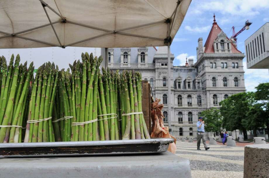 Asparagus and other fresh produce are for sale on the tables of Samascott Orchards, of Kinderhook, at the farmers' market on the Empire State Plaza on Wednesday June 6, 2012 in Albany, NY.  Access to farmer's markets would improve under a bipartisan farm bill that U.S. Senators Charles Schumer and Kirsten Gillibrand are working on .(Philip Kamrass / Times Union ) Photo: Philip Kamrass / 00017991A