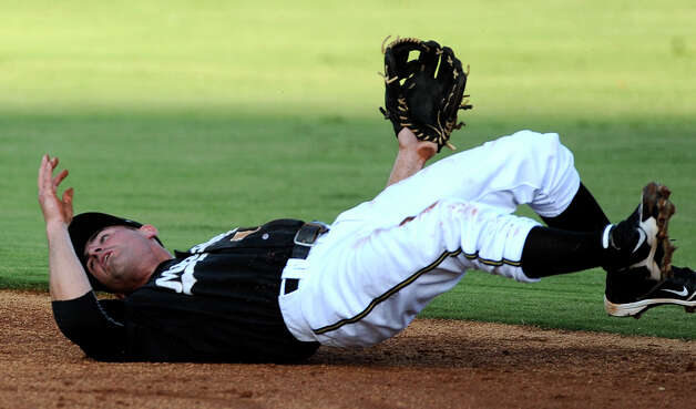 Missions second baseman Dean Anna rolls on the ground after successfully throwing to second for a force out during Texas League action at Wolff Stadium on Wednesday, June 6, 2012. Photo: Billy Calzada, San Antonio Express-News / © 2012 San Antonio Express-News