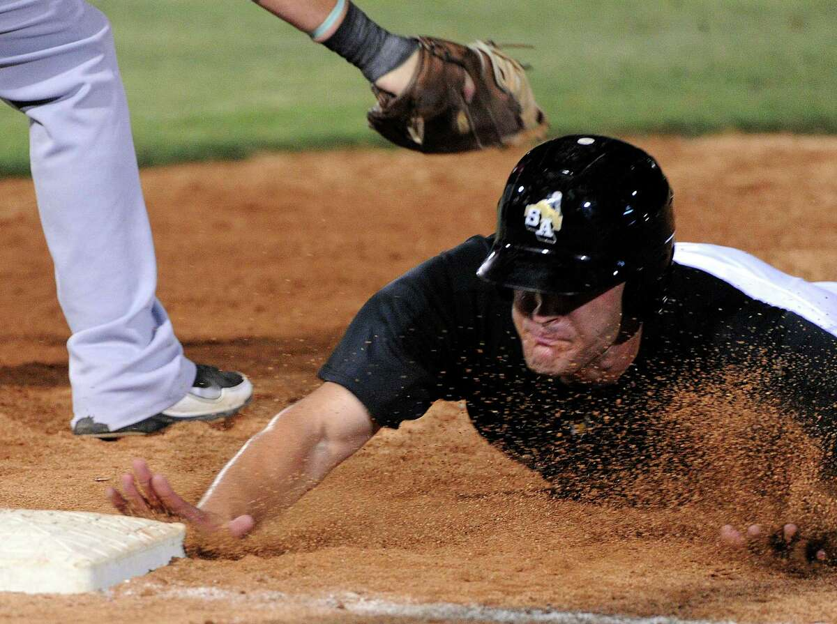 The Missions' Nate Freiman reaches first base safely on a pickoff attempt as Frisco's Chris McGuiness applies a tag during Texas League action at Wolff Stadium on Wednesday, June 6, 2012.
