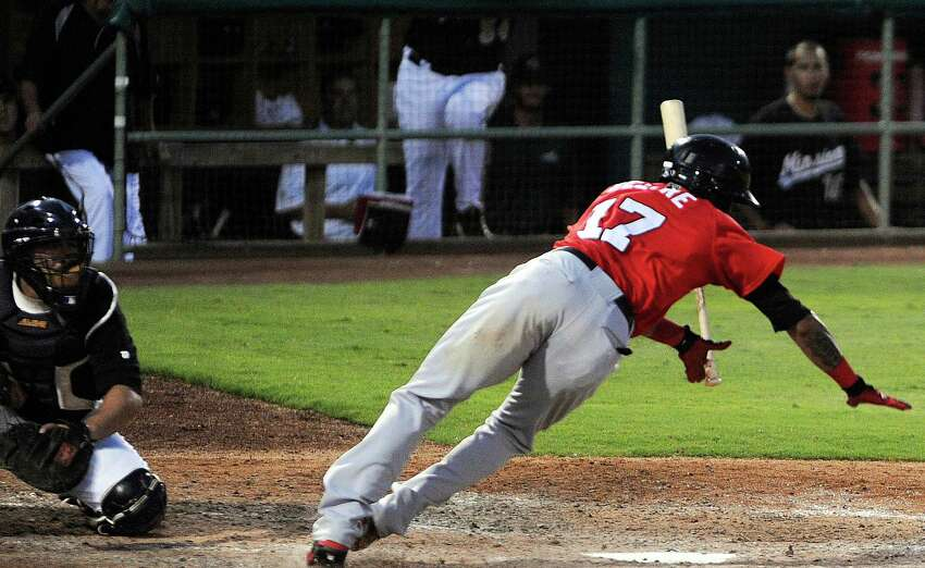 Frisco's Engel Beltre is hit by a pitch during Texas League action at Wolff Stadium on Wednesday, June 6, 2012.