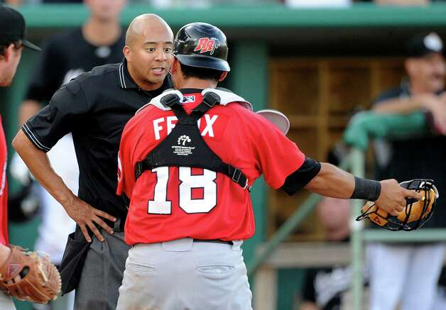 Home plate umpire Will Thornewell listens as Frisco catcher Jose Felix argues after a close play at the plate during Texas League action against the Missions at Wolff Stadium on Wednesday, June 6, 2012. Photo: Billy Calzada, San Antonio Express-News / © 2012 San Antonio Express-News