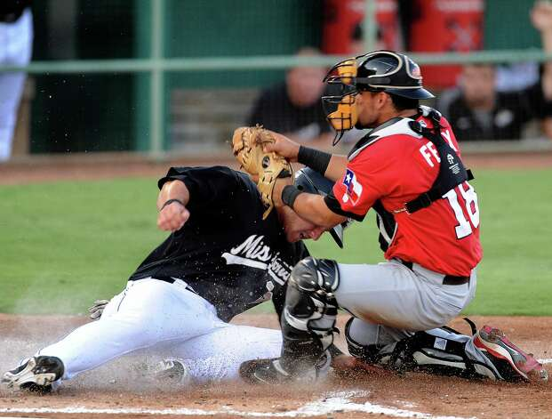 The Missions' Jason Hagerty slides in safely as Frisco catcher Jose Felix applies the tag during Texas League action at Wolff Stadium on Wednesday, June 6, 2012. Photo: Billy Calzada, San Antonio Express-News / © 2012 San Antonio Express-News