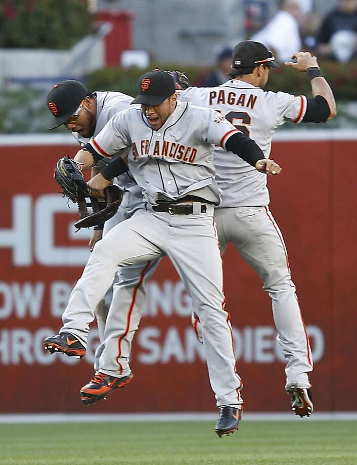 San Francisco Giants outfielders Angel Pagan, right, Melky Cabrera, left, and Gregor Blanco celebrate the Giants' 6-5 victory over the San Diego Padres in a baseball game Wednesday, June 6, 2012 in San Diego. (AP Photo/Lenny Ignelzi) Photo: Lenny Ignelzi, Associated Press