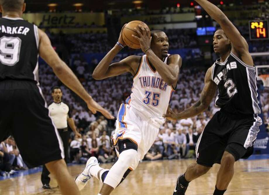 Oklahoma City Thunder's Kevin Durant (35) drives against San Antonio Spurs' Kawhi Leonard (2) during the first half of game six of the NBA Western Conference Finals in Oklahoma City, Okla. on Wednesday, June 6, 2012. (Jerry Lara / San Antonio Express-News)