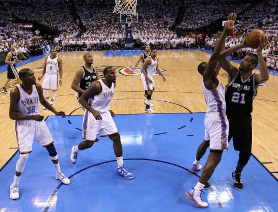 San Antonio Spurs' Tim Duncan (21) shoots over Oklahoma City Thunder's Serge Ibaka (9) during the first half of game six of the NBA Western Conference Finals in Oklahoma City, Okla. on Wednesday, June 6, 2012. (Jerry Lara / San Antonio Express-News)