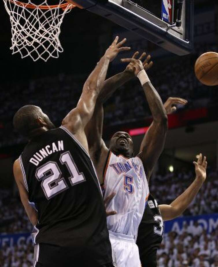 Oklahoma City Thunder's Kendrick Perkins (5) shoots against San Antonio Spurs' Tim Duncan (21) during the first half of game six of the NBA Western Conference Finals in Oklahoma City, Okla. on Wednesday, June 6, 2012. (Jerry Lara / San Antonio Express-News)