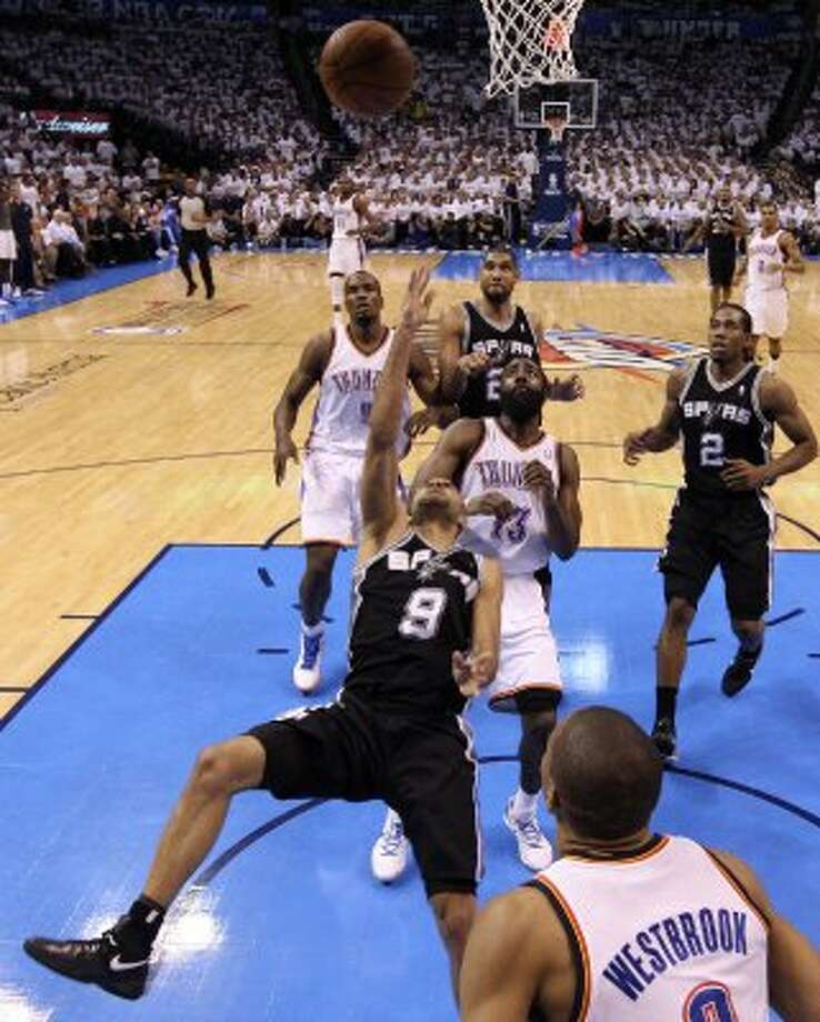 San Antonio Spurs' Tony Parker (9) shoots the ball during the first half of game six of the NBA Western Conference Finals in Oklahoma City, Okla. on Wednesday, June 6, 2012. (Jerry Lara / San Antonio Express-News)