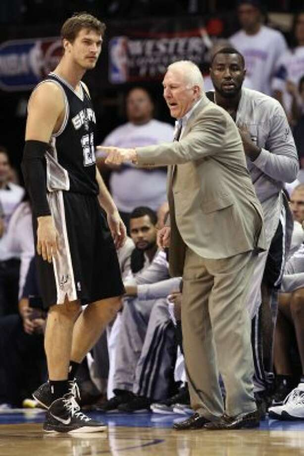 San Antonio Spurs coach Gregg Popovich talks to San Antonio Spurs' Tiago Splitter (22) during the second half of game six of the NBA Western Conference Finals in Oklahoma City, Okla. on Wednesday, June 6, 2012. (Jerry Lara / San Antonio Express-News)
