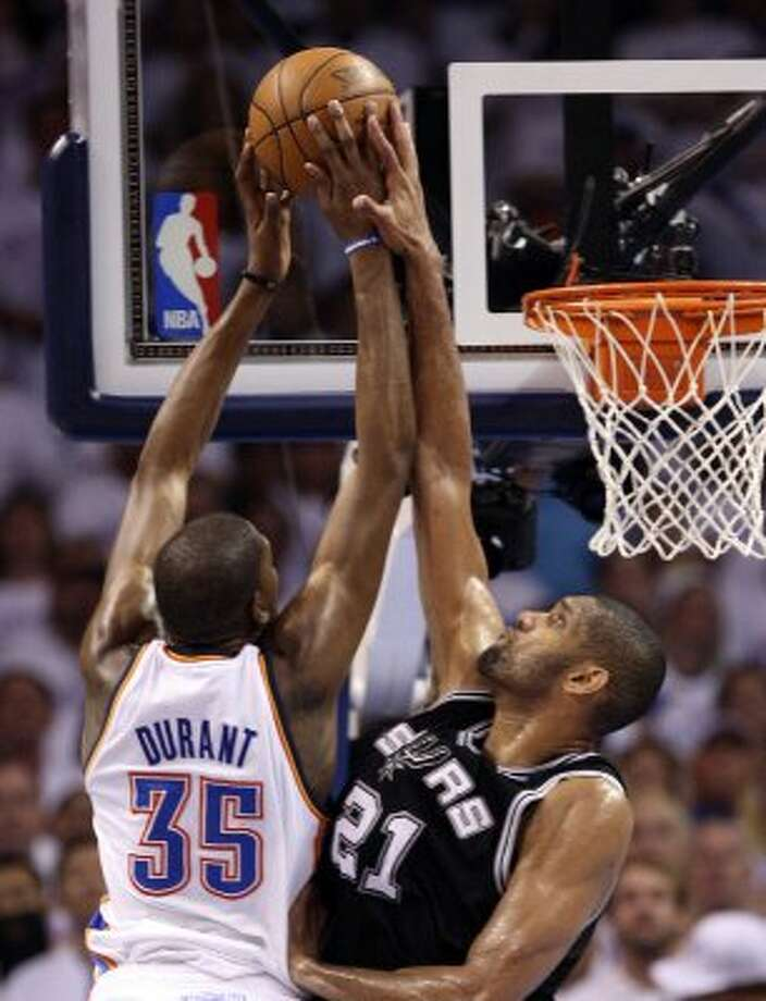 Oklahoma City Thunder's Kevin Durant (35) goes to the basket against San Antonio Spurs' Tim Duncan (21) during the second half of game six of the NBA Western Conference Finals in Oklahoma City, Okla. on Wednesday, June 6, 2012. (Jerry Lara / San Antonio Express-News)