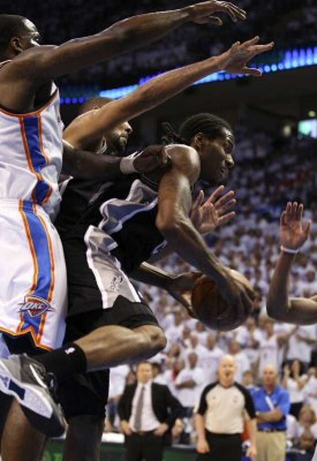 San Antonio Spurs' Kawhi Leonard (2) pulls down a rebound the second half of game six of the NBA Western Conference Finals in Oklahoma City, Okla. on Wednesday, June 6, 2012. (Jerry Lara / San Antonio Express-News)