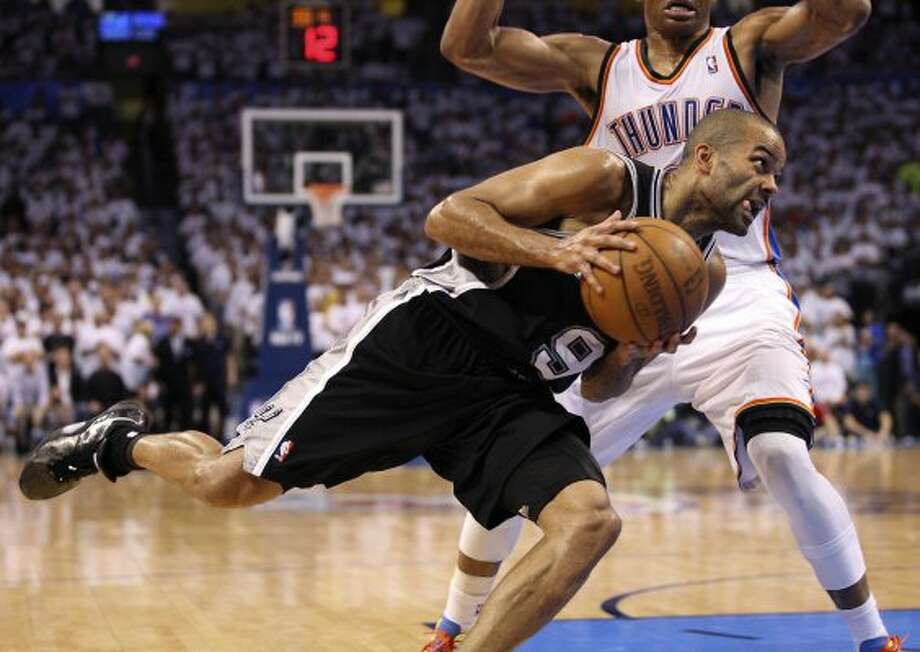 San Antonio Spurs' Tony Parker (9) drives around Oklahoma City Thunder's Russell Westbrook (0) during the second half of game six of the NBA Western Conference Finals in Oklahoma City, Okla. on Wednesday, June 6, 2012. (Jerry Lara / San Antonio Express-News)