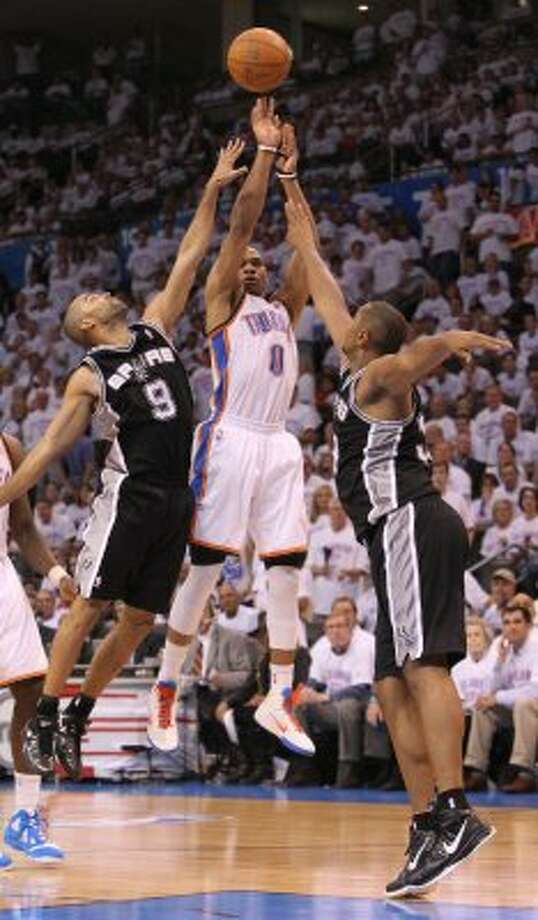 during the second half of game six of the NBA Western Conference Oklahoma City Thunder's Russell Westbrook (0) shoots against San Antonio Spurs' Tony Parker (9) and San Antonio Spurs' Boris Diaw (33) Finals in Oklahoma City, Okla. on Wednesday, June 6, 2012. (Kin Man Hui / San Antonio Express-News)