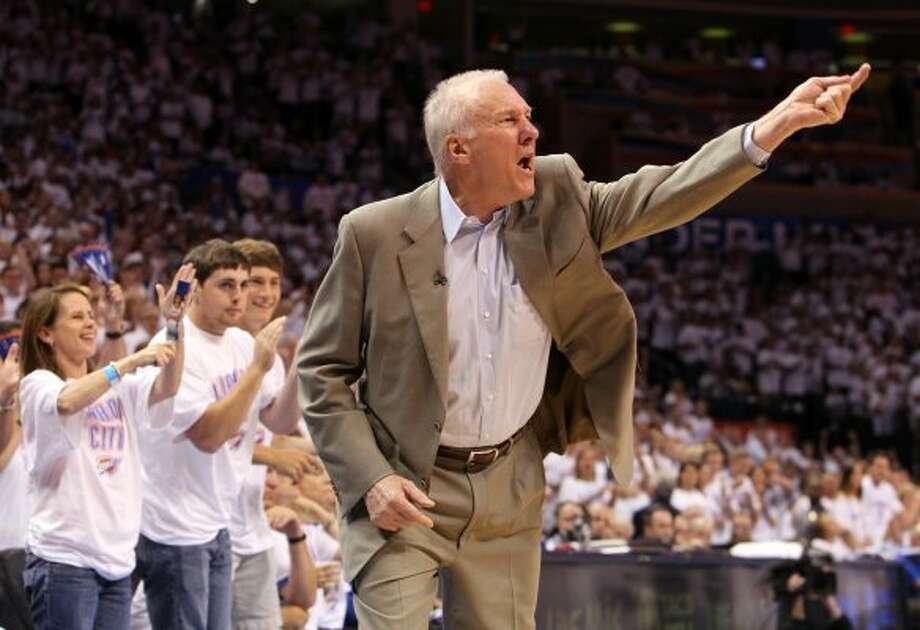 San Antonio Spurs coach Gregg Popovich gestures during the second half of game six of the NBA Western Conference Finals in Oklahoma City, Okla. on Wednesday, June 6, 2012. (Kin Man Hui / San Antonio Express-News)
