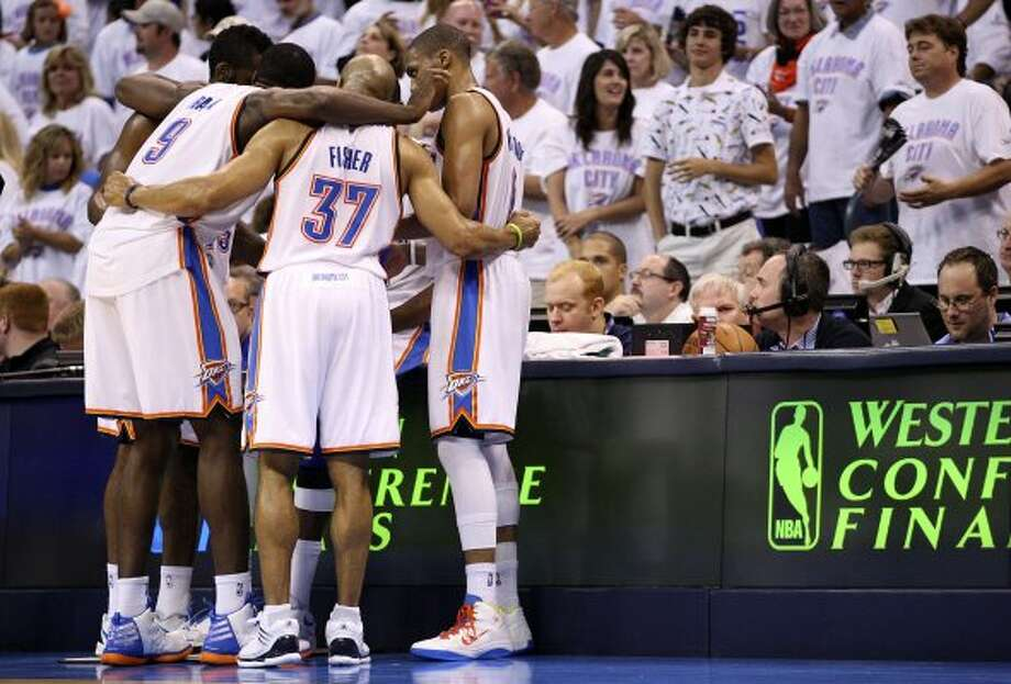 The Oklahoma City Thunder huddle during the second half of game six of the NBA Western Conference Finals in Oklahoma City, Okla. on Wednesday, June 6, 2012. (Jerry Lara / San Antonio Express-News)