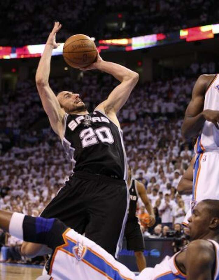 San Antonio Spurs' Manu Ginobili (20) puts up a shot against Oklahoma City Thunder's Kevin Durant (35) during the second half of game six of the NBA Western Conference Finals in Oklahoma City, Okla. on Wednesday, June 6, 2012. (Jerry Lara / San Antonio Express-News)