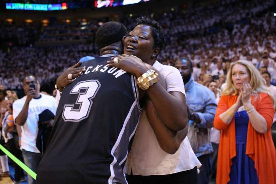 San Antonio Spurs' Stephen Jackson (3) embraces Wanda Pratt, the mother of Kevin Durant, after the second half of game six of the NBA Western Conference Finals in Oklahoma City, Okla. on Wednesday, June 6, 2012.  The Thunder won 107-99. (Jerry Lara / San Antonio Express-News)