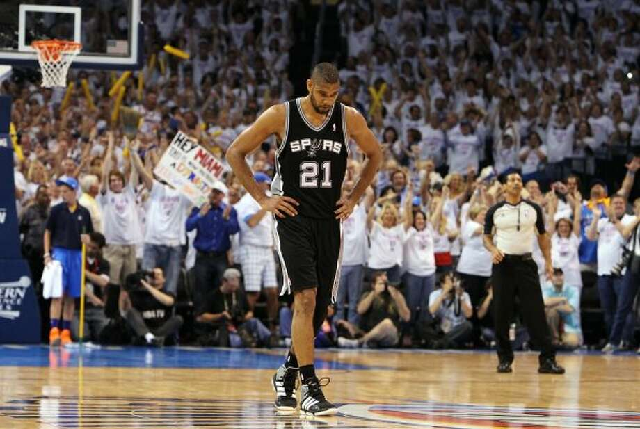 Spurs' Tim Duncan solemnly walks up court in the closing moments of Game 6 against the Oklahoma Thunder during the second half of the NBA Western Conference Finals in Oklahoma City, Okla. on Wednesday, June 6, 2012.  The Thunder won 107-99. (Kin Man Hui / San Antonio Express-News)
