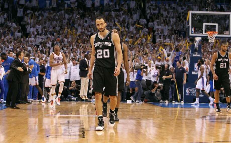 Spurs' Manu Ginobili (20) walks back to the bench in the closing moments of the second half against the Oklahoma Thunder of game six of the NBA Western Conference Finals in Oklahoma City, Okla. on Wednesday, June 6, 2012.  The Thunder won 107-99. (Kin Man Hui / San Antonio Express-News)