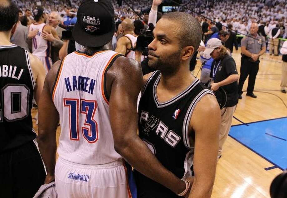 Spurs' Tony Parker (right) hugs Thunder's James Harden after the Thunder defeated the Spurs in game six of the NBA Western Conference Finals in Oklahoma City, Okla. on Wednesday, June 6, 2012.  The Thunder won 107-99. (Kin Man Hui / San Antonio Express-News)