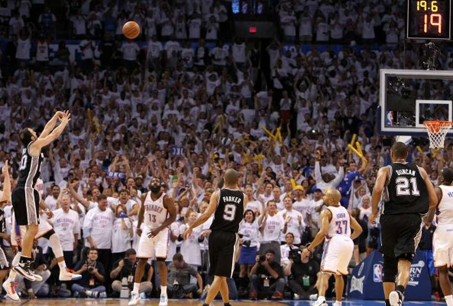 San Antonio Spurs' Manu Ginobili (20) shoots a three point basket during the second half of game six of the NBA Western Conference Finals in Oklahoma City, Okla. on Wednesday, June 6, 2012.  The Thunder won 107-99. (Kin Man Hui / San Antonio Express-News)