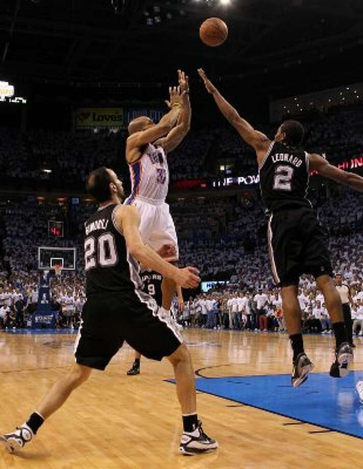 Oklahoma City Thunder's Derek Fisher (37) shoots over San Antonio Spurs' Manu Ginobili (20) and San Antonio Spurs' Kawhi Leonard (2) during the second half of game six of the NBA Western Conference Finals in Oklahoma City, Okla. on Wednesday, June 6, 2012.  The Thunder won 107-99. (Kin Man Hui / San Antonio Express-News)