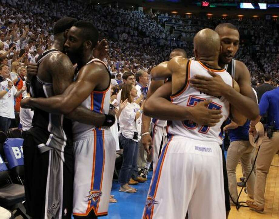 San Antonio Spurs' Stephen Jackson (3) hugs Oklahoma City Thunder's James Harden (13) and San Antonio Spurs' Boris Diaw (33) hugs Oklahoma City Thunder's Derek Fisher (37) after game six of the NBA Western Conference Finals in Oklahoma City, Okla. on Wednesday, June 6, 2012.  The Thunder won 107-99. (Kin Man Hui / San Antonio Express-News)