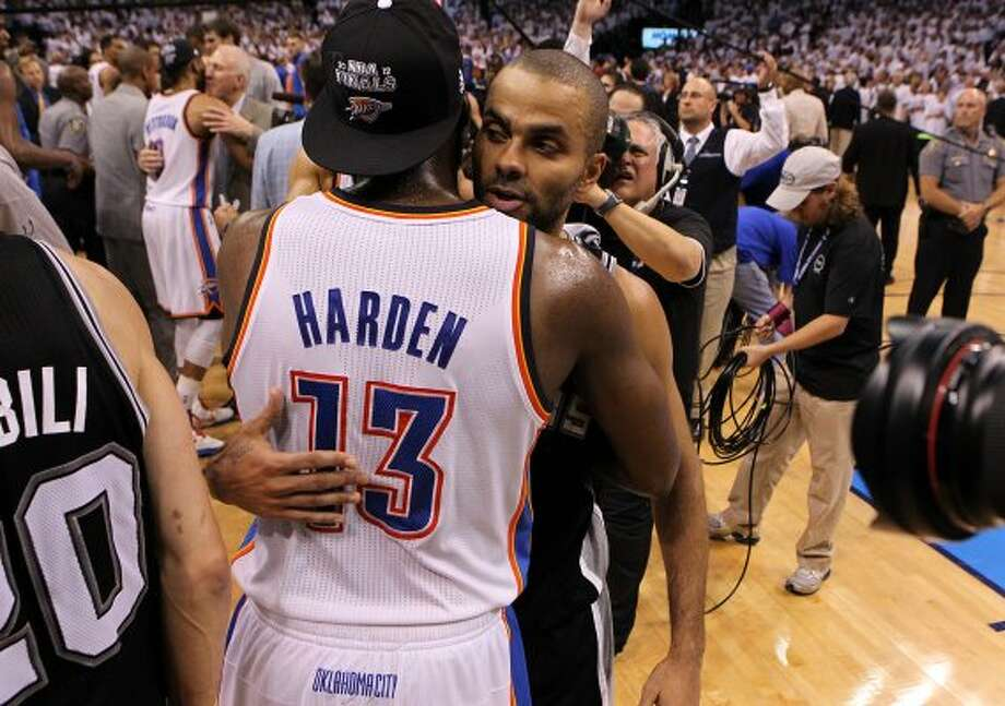 San Antonio Spurs' Tony Parker (9) hugs Oklahoma City Thunder's James Harden (13) after game six of the NBA Western Conference Finals in Oklahoma City, Okla. on Wednesday, June 6, 2012.  The Thunder won 107-99. (Kin Man Hui / San Antonio Express-News)