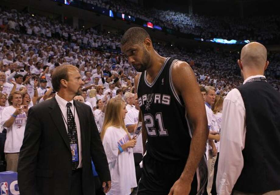 San Antonio Spurs' Tim Duncan (21) walks off the court after game six of the NBA Western Conference Finals in Oklahoma City, Okla. on Wednesday, June 6, 2012.  The Thunder won 107-99. (Kin Man Hui / San Antonio Express-News)
