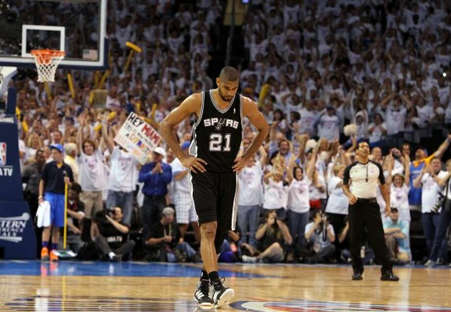 San Antonio Spurs' Tim Duncan (21) walks down the court during the second half of game six of the NBA Western Conference Finals in Oklahoma City, Okla. on Wednesday, June 6, 2012.  The Thunder won 107-99. (Kin Man Hui / San Antonio Express-News)