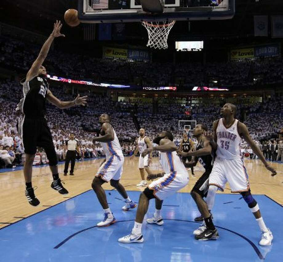 San Antonio Spurs' Tim Duncan (21) shoots the ball during the second half of game six of the NBA Western Conference Finals in Oklahoma City, Okla. on Wednesday, June 6, 2012.  The Thunder won 107-99. (Kin Man Hui / San Antonio Express-News)