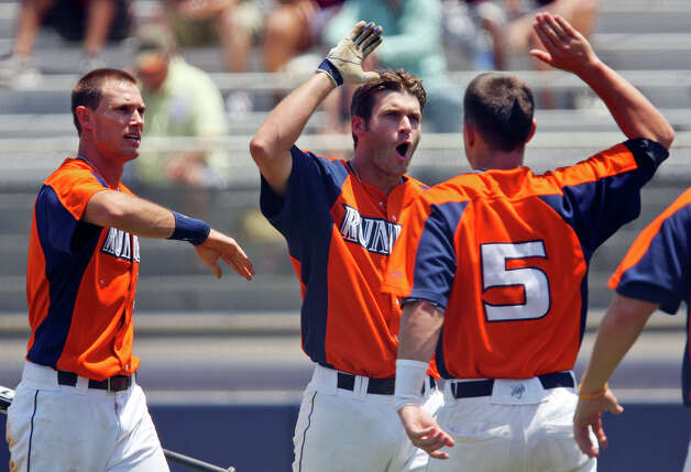 UTSA's Ryan Hutson (center) celebrates with teammates Casey Selsor (left) and Ryan Dalton (right) after hitting a home run against Texas State during the fourth inning on May 8, 2011 at Roadrunner Field. Texas State won 7-6. Photo: EDWARD A. ORNELAS, San Antonio Express-News / SAN ANTONIO EXPRESS-NEWS (NFS)