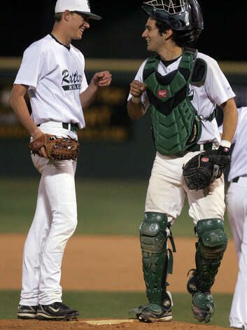 Reagan pitcher Casey Selsor and catcher Santiago Ruiz bump fists on March 19, 2008 at Blossom baseball field. Photo: Express-News File Photo / SAN ANTONIO EXPRESS NEWS