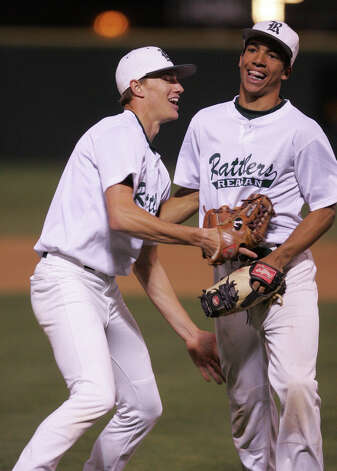 Reagan's Casey Selsor and Derrick Walls share a laugh on March 19, 2008 at Blossom baseball field. Photo: Express-News File Photo / SAN ANTONIO EXPRESS NEWS