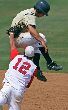 Kerrville Tivy baserunner Logan Vick tries to leap over the tag of the Hays Consolidated's Ryan Slaughter after getting caught off the bag at second when Slaughter caught a short fly ball at Blossom baseball field on May 10, 2008. Photo: TOM REEL, San Antonio Express-News / SAN ANTONIO EXPRESS-NEWS