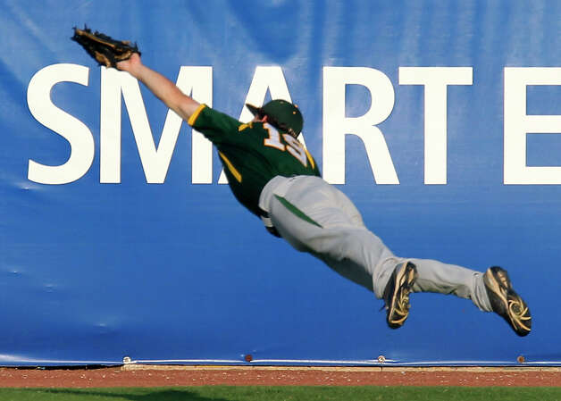 Baylor's Logan Vick (19) snags a shot in center field against UTSA in the first inning at Wolff Stadium on April 26, 2011. Photo: KIN MAN HUI, San Antonio Express-News / San Antonio Express-News