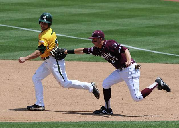 Baylor's Logan Vick (left) is tagged out by Texas A&M's Jacob House during the third inning April 17,  2011, at Olsen Field in College Station. Photo: AP Photo / Waco Tribune Herald, Rod Aydelotte