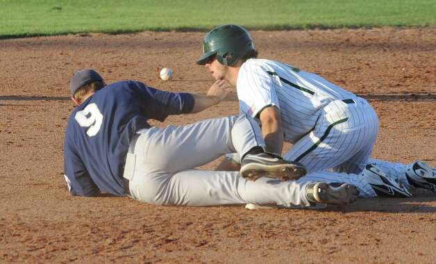 Baylor Logan Vick (right) slides into second as Oral Roberts second baseman Cam Schiller (left) drops the ball in the fifth inning of their NCAA college baseball tournament regional game on June 1, 2012, in Waco. Photo: AP Photo / Waco Tribune Herald, Rod Aydelotte