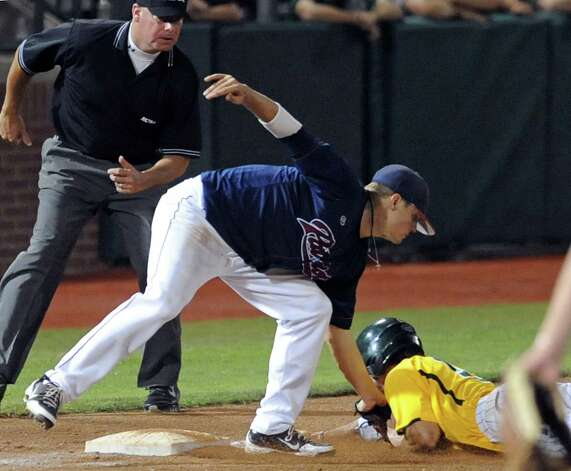 Dallas Baptist's Kenny Hatcher (left) tags out Baylor's Logan Vick on an attempt to steal third during the seventh inning of their NCAA college baseball tournament regional game June 3, 2012, in Waco. Photo: AP Photo / Waco Tribune Herald, Rod Aydelotte