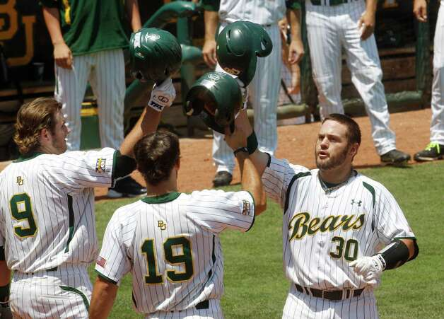 Baylor's Josh Ludy (30) celebrates his home run with teammates Max Muncy (9) and Logan Vick (19) in the fourth inning of an NCAA Big 12 college baseball tournament game against Kansas State in Oklahoma City on May 23, 2012. Baylor won 11-1 in seven innings. Photo: Sue Ogrocki / Associated Press