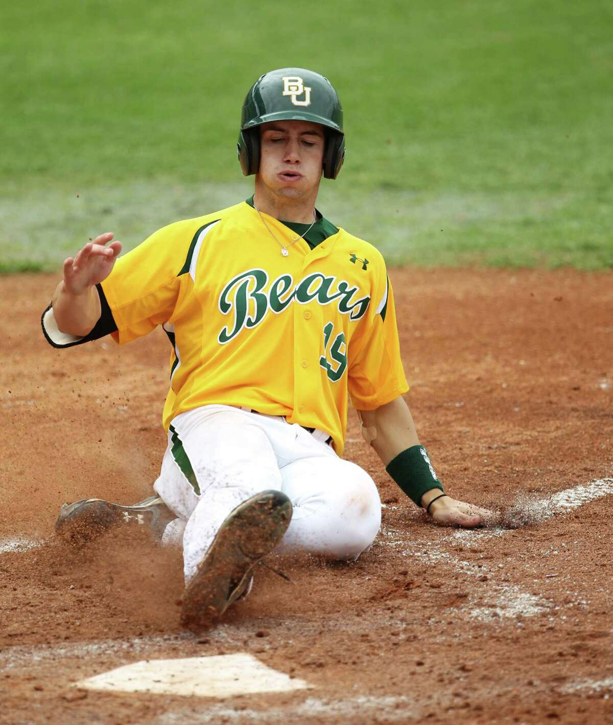 Baylor's Logan Vick slides in 2010. Vick, a Kerrville Tivy graduate and junior at Baylor, was taken in the 11th round (353rd overall) by Cleveland.