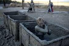 Tourists enjoy mineral-rich mud at the Israeli Dead Sea resort of Ein Gedi on June 6, 2012. AFP PHOTO/MENAHEM KAHANAMENAHEM KAHANA/AFP/GettyImages