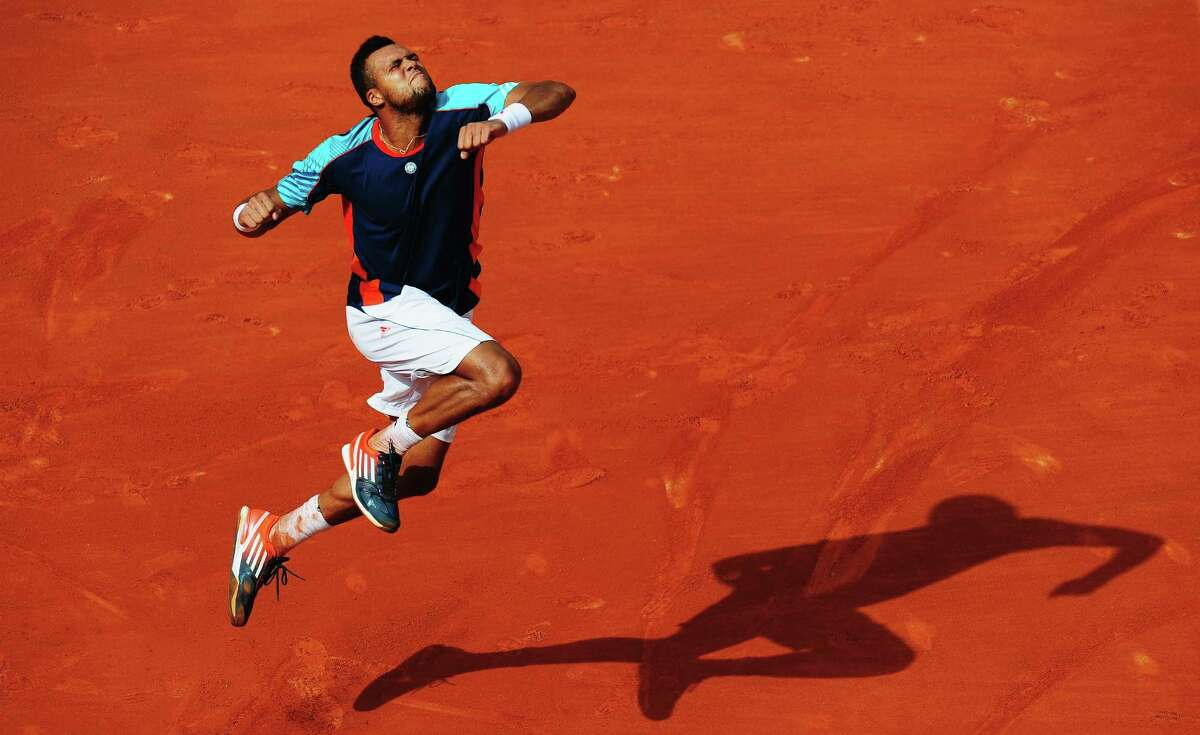 PARIS, FRANCE - JUNE 01: Jo-Wilfried Tsonga of France celebrates victory in his men's singles third round match against Fabio Fognini of Italy during day six of the French Open at Roland Garros on June 1, 2012 in Paris, France.
