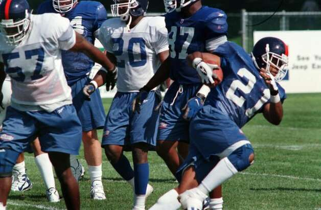 Times Union Staff Photo by Steve Jacobs:   Giants' running back  #21, Tiki Barber carries the ball during first day of training camp  at the UAlbany football field Saturday morning July 25,1998. (DG)