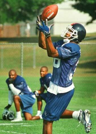 Times Union staff photograph by --Michael P. Farrell--SATURDAY July 31, 1999--ALBANY, N.Y.--Giants free agent cornerback Kevin Suggs (#38) makes an interception during practice  at  New York Giants training camp at the State Universty of Albany, Saturday. (DG)