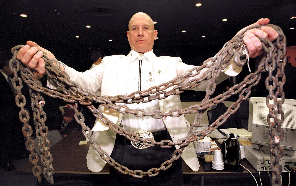 Jasper County Assistant District Attorney Pat Hardy displays the chain allegedly used to drag James Byrd Jr. to his death during a break in the trial of Lawrence Russell Brewer Thursday, Sept. 16, 1999, at the Brazos County Courthouse in Bryan, Texas. The chain was introduced into evidence Thursday. Brewer is the second of three white men charged with capital murder in the dragging death of James Byrd Jr. near Jasper, Texas. (AP Photo/Pool, Butch Ireland)