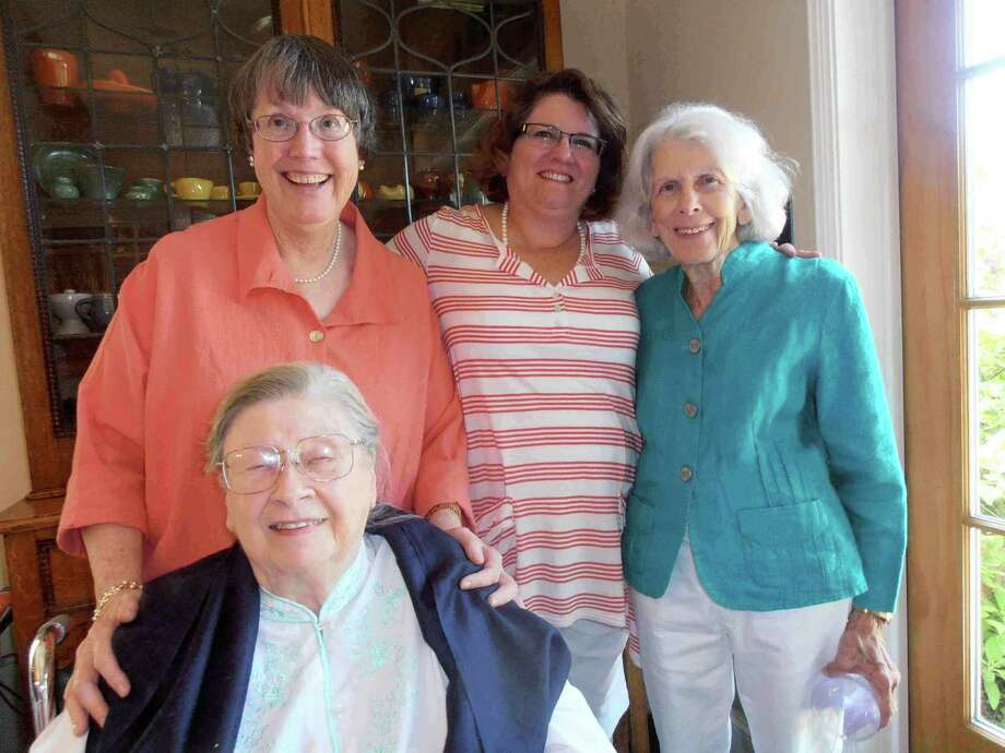 Cecilia Steinfeldt (seated) receives birthday greetings from Susan Frost (standing, from left), Rebecca Norton and Martha Utterback at a birthday party. Photo: Nancy Cook-Monroe